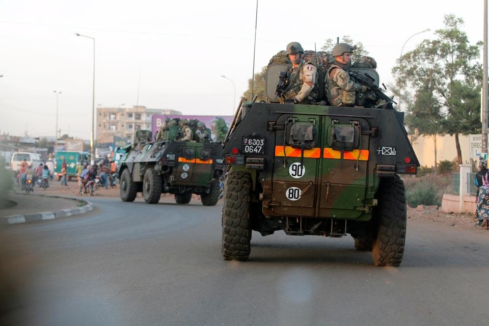 French troops in two armoured personnel carriers drive through Mali's capital Bamako on the road to Mopti Tuesday Jan. 15 2013. (AP / Jerome Delay)