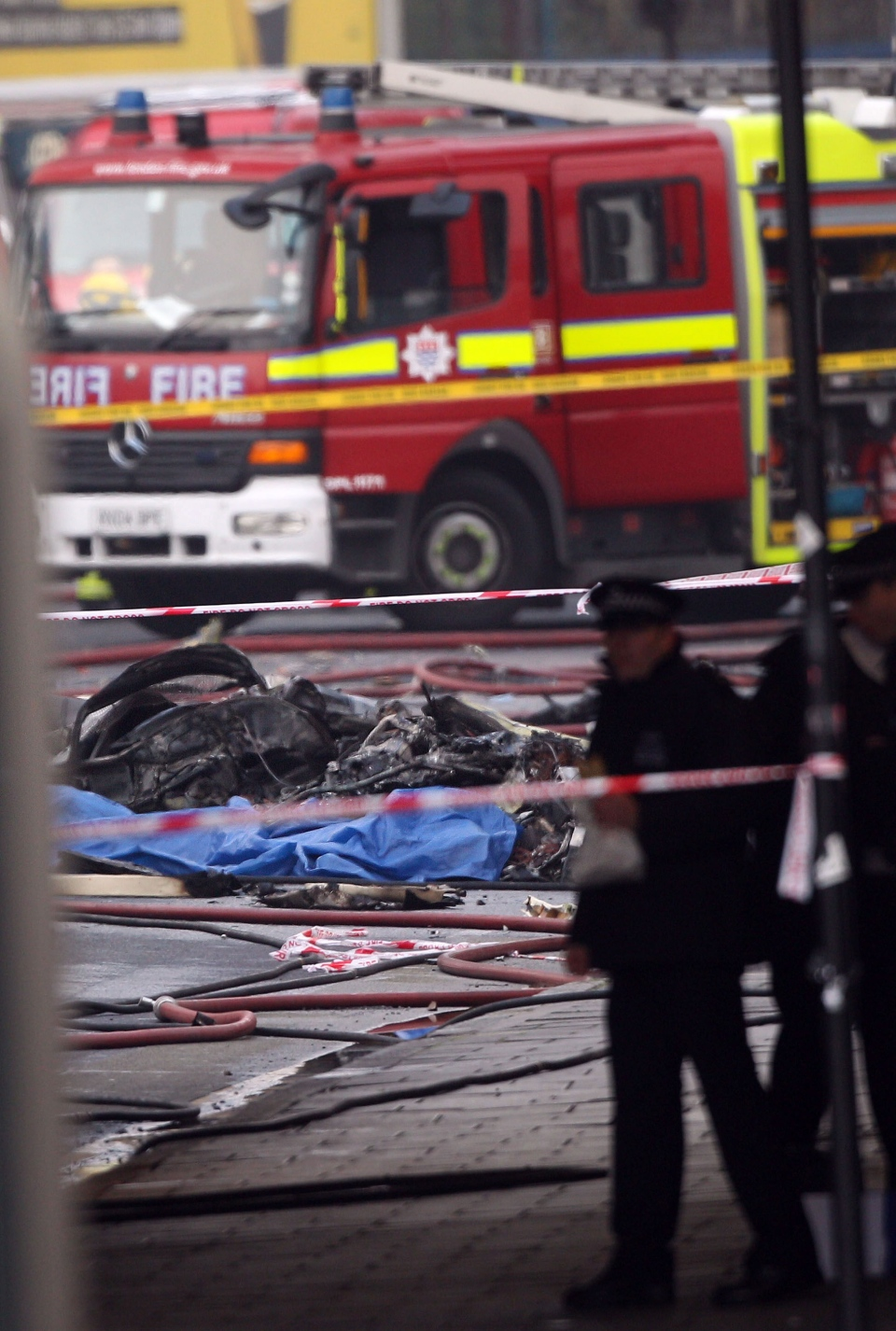 Debris lies on the ground after a helicopter crashed into a construction crane on top of St George's Wharf tower building, in Vauxhall south London Wednesday, Jan. 16, 2013. (Lewis Whyld / PA)