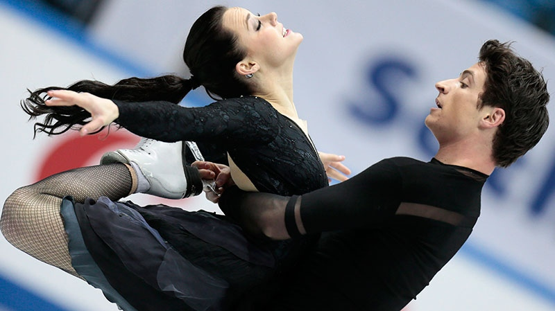Tessa Virtue and Scott Moir, of Canada, skate their free dance to win the silver at the ISU figure skating Grand Prix Final event, at Iceberg stadium in Sochi, Russia, on Saturday, Dec. 8, 2012. (AP / Ivan Sekretarev)