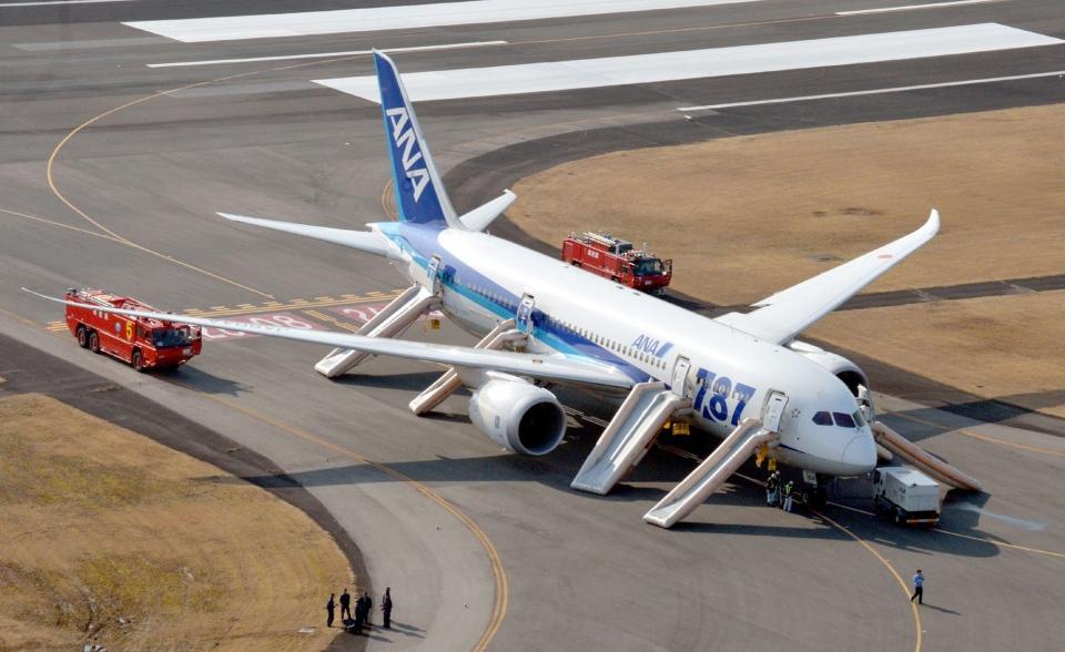 An All Nippon Airways flight sits at Takamatsu airport in Takamatsu, western Japan after it made an emergency landing Wednesday, Jan. 16, 2013.  (AP / Kyodo News)