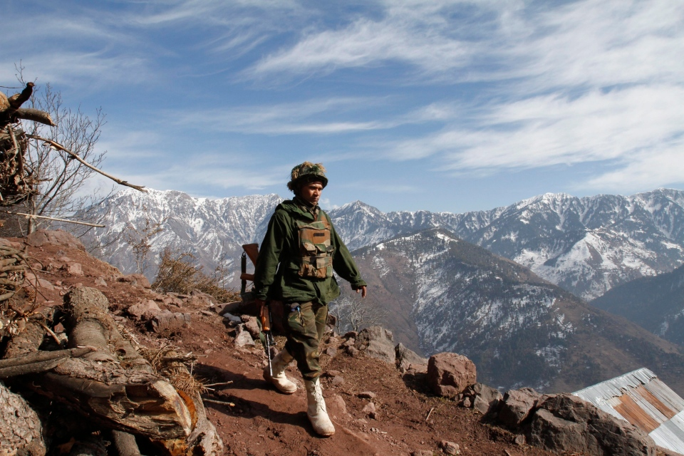 An Indian army soldier patrols near the Line of Control (LOC), the line that divides Kashmir between India and Pakistan, in Churunda village, about 150 Kilometers northwest of Srinagar, India, Tuesday, Jan. 15, 2013. (AP / Mukhtar Khan)