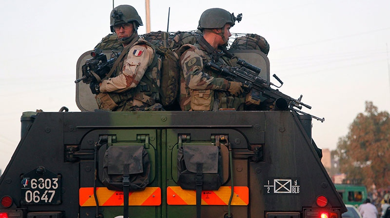 French troops in two armored personnel carriers drive through Mali's capital Bamako on the road to Mopti Tuesday Jan. 15, 2013. (AP / Jerome Delay)