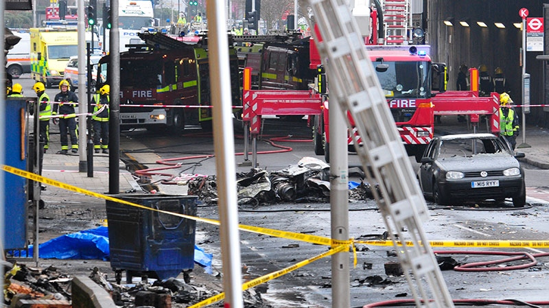 Debris lies on the ground after a helicopter crashed into a construction crane on top of St George's Wharf tower building, in London, Wednesday Jan. 16, 2013. (AP / Vince Pol)