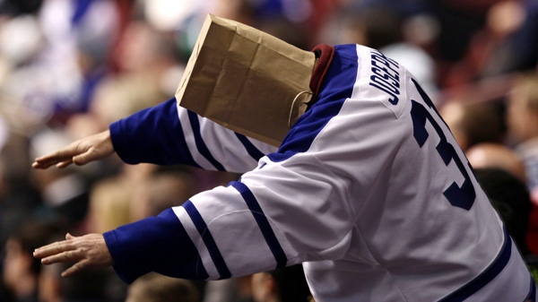A Toronto Maple Leafs fan wears a paper bag on his head after the Vancouver Canucks scored their fourth goal against the Leafs during the third period of an NHL hockey game in Vancouver, B.C., on Saturday December 18, 2010. (THE CANADIAN PRESS/Darryl Dyck)