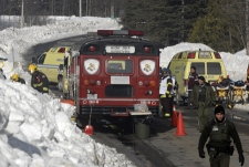 Rescue personnel stand by at the scene of a roof collapse in Morin Heights, Que., northwest of Montreal, on Wednesday, March 12, 2008. (Peter McCabe / THE CANADIAN PRESS)
