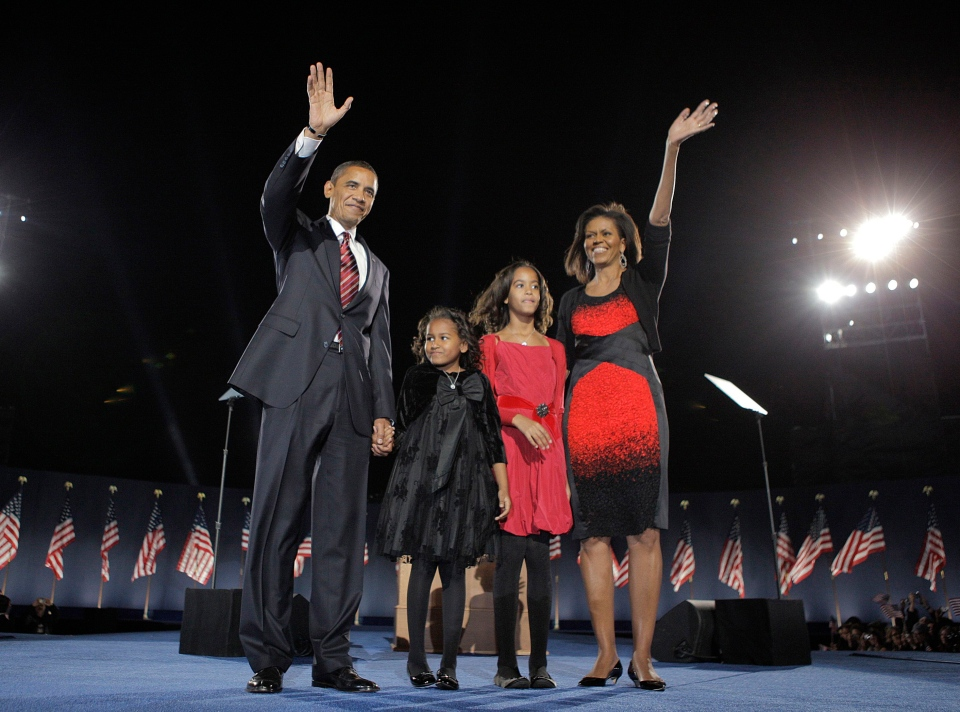 President-elect Barack Obama, left, his wife Michelle Obama, right, and two daughters, Sasha, 7, and Malia, 10, second from right, as they wave at the election night rally in Chicago in this Nov. 4, 2008 file photo. (AP Photo/Jae C. Hong)
