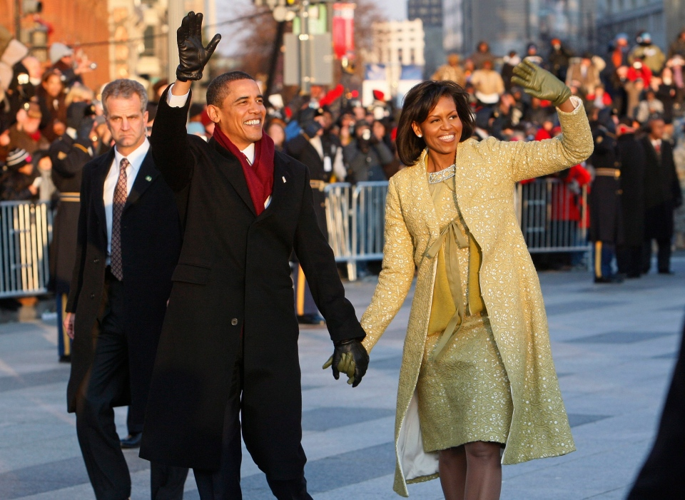 President Barack Obama and first lady Michelle Obama walk the inaugural parade route in Washington in this Jan. 20, 2009 file photo. (AP Photo/Charles Dharapak)