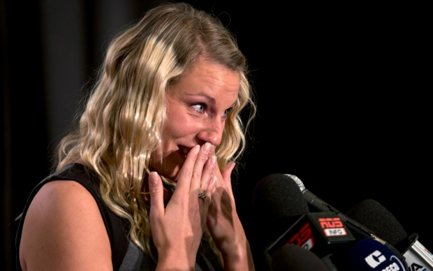 Canadian diver Emilie Heymans, who medalled in four consecutive Olympics, fights back tears as she announces her retirement from competition, in Montreal, Wednesday, January 16, 2013. (Paul Chiasson / THE CANADIAN PRESS)