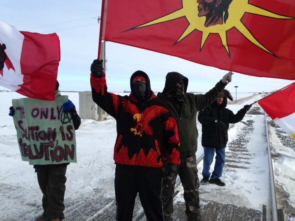 A small group of protesters are shown blocking the main CN rail line west of Portage la Prairie, Man., on Wednesday, Jan. 16, 2013. (Jill Machyson / CTV News)