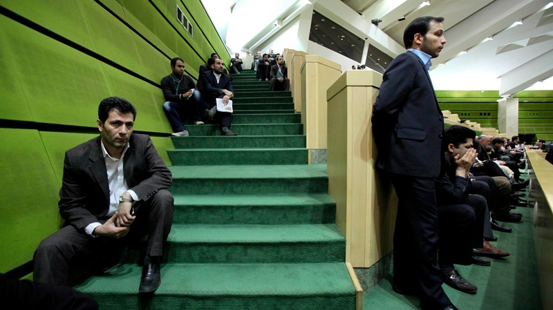 Iranian spectators follow President Mahmoud Ahmadinejad's speech at the parliament in Tehran, Iran, Wednesday, Jan. 16, 2013. (AP / Vahid Salemi)
