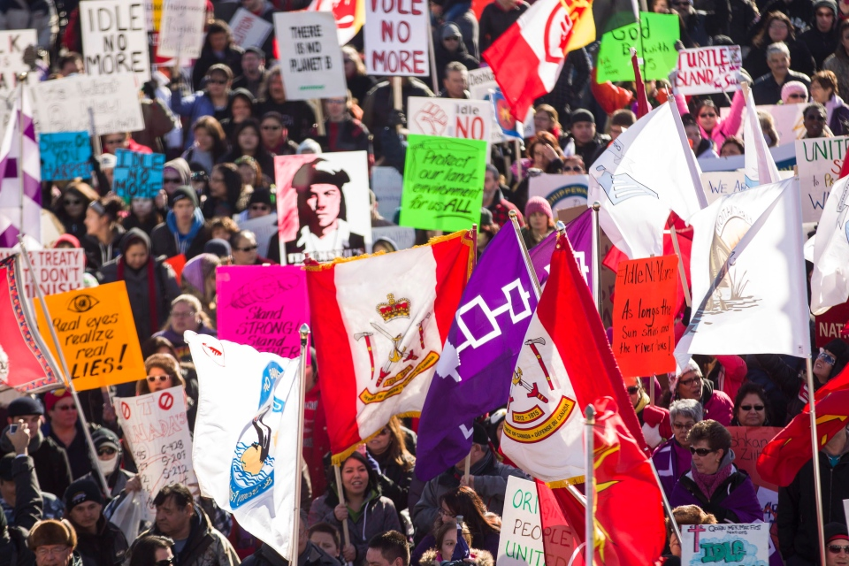 Idle No More protesters march towards the Ambassador Bridge in Windsor, Ont., on Wednesday, Jan. 16, 2013. (Geoff Robins / THE CANADIAN PRESS)