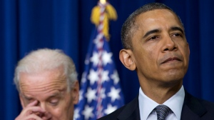 President Barack Obama, accompanied by Vice President Joe Biden, pauses as he talks about proposals to reduce gun violence, Wednesday, Jan. 16, 2013, in the South Court Auditorium at the White House in Washington. (AP / Carolyn Kaster)