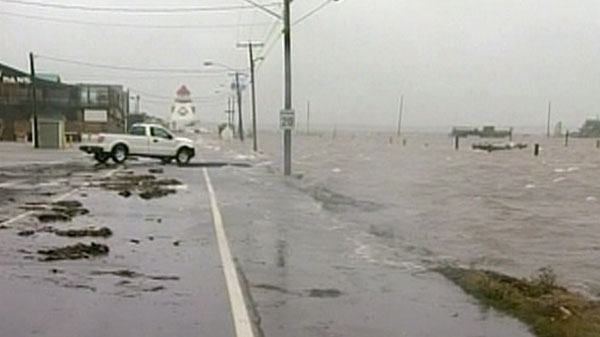 A storm surged in Pointe-du-Chene, New Brunswick causing water to overflow can be seen in this undated photo.