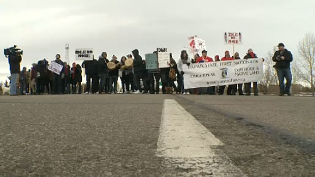 A local First Nations group holds a blockade on the Queen Elizabeth II Highway on Wednesday, Jan. 16, 2013, as part of an Idle No More national day of action.