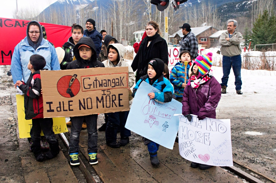 Members of the Gitxsan First Nation blockade a CN railroad track in Kitwanga, B.C., between Terrace and Smithers, on Wednesday, Jan. 16, 2013. (Robin Rowland / THE CANADIAN PRESS)