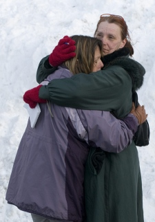 Friends and family grieve at the scene of a building collapse in Morin Heights, Que., northwest of Montreal, on Wednesday, March 12, 2008. (Peter McCabe / THE CANADIAN PRESS)