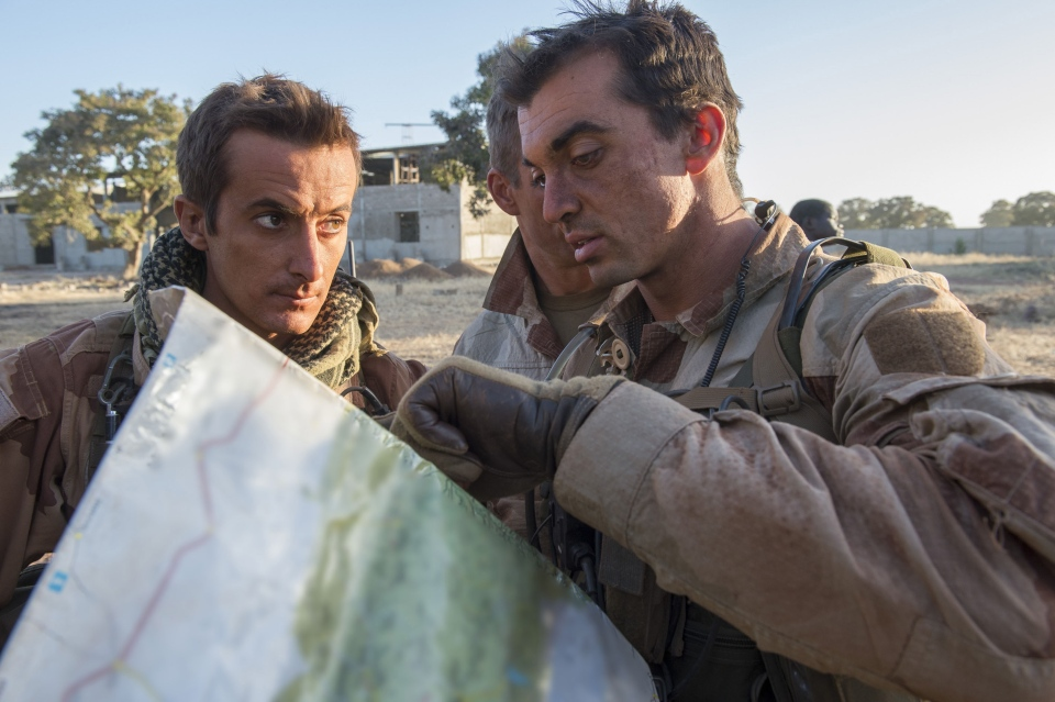 French soldiers check a map at an undisclosed location, north of the Malian capital, Bamako, Wednesday, Jan. 16, 2013. (AP / Arnaud Roine, ECPAD)