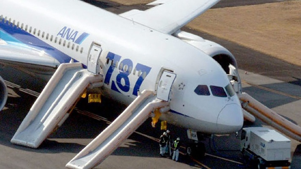 An All Nippon Airways flight sits on the tarmac at Takamatsu airport in Takamatsu, Japan after it made an emergency landing on Wednesday, Jan. 16, 2013. (AP Photo/Kyodo News)