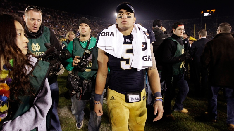 In this Nov. 17, 2012, file photo, Notre Dame linebacker Manti Te'o walks off the field following an NCAA college football game against Wake Forest in South Bend, Ind. (AP Photo/Michael Conroy, File)