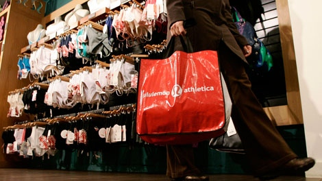 A woman leaves after shopping at the Kitsilano Lululemon store in Vancouver Thursday, Oct. 18, 2007. (THE CANADIAN PRESS/Richard Lam)