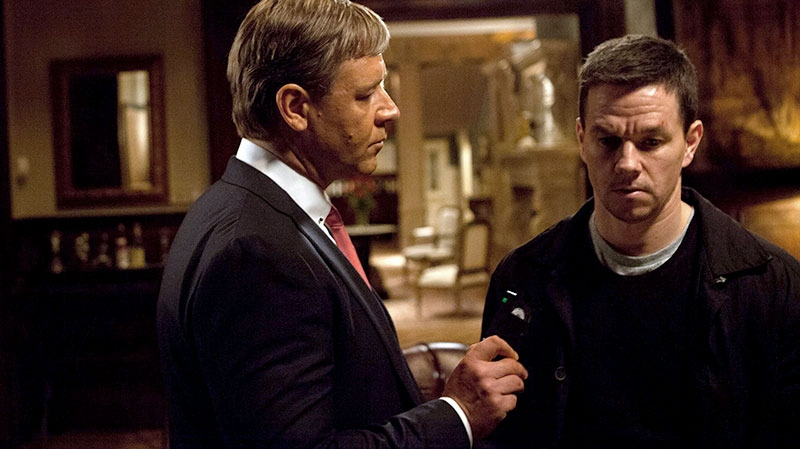 Russell Crowe, left, and Mark Wahlberg in a scene from eOne Films Canada's 'Broken City'