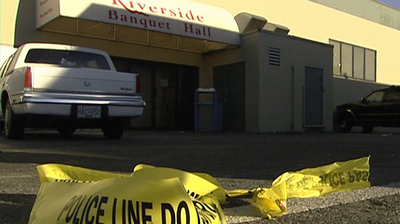 Police tape lies on the ground outside of a banquet hall in B.C. following a shooting, Thursday, Jan. 17, 2013.