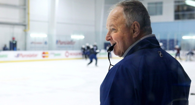 Toronto Maple Leafs coach Randy Carlyle watches players warm up during a training session as the Leafs prepare for the new NHL season in Toronto on Tuesday January 15, 2013. THE CANADIAN PRESS/Chris Young