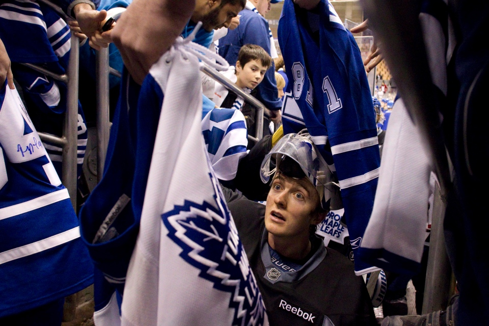 Toronto Maple Leafs goaltender Ben Scrivens signs a fan's shirt following an open training session at the Air Canada Centre in Toronto on Thursday, Jan. 17, 2013. (Chris Young / THE CANADIAN PRESS)