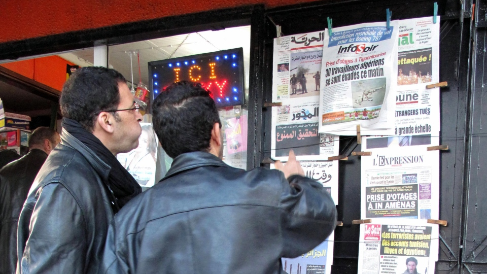 Algerian men look at national newspapers headlining the terrorist attack and kidnapping at a news stand in Algiers on Thursday, Jan. 17, 2013. Information on the Algerian assault in the remote area is wildly varying. (AP / Ouahab Hebbat)