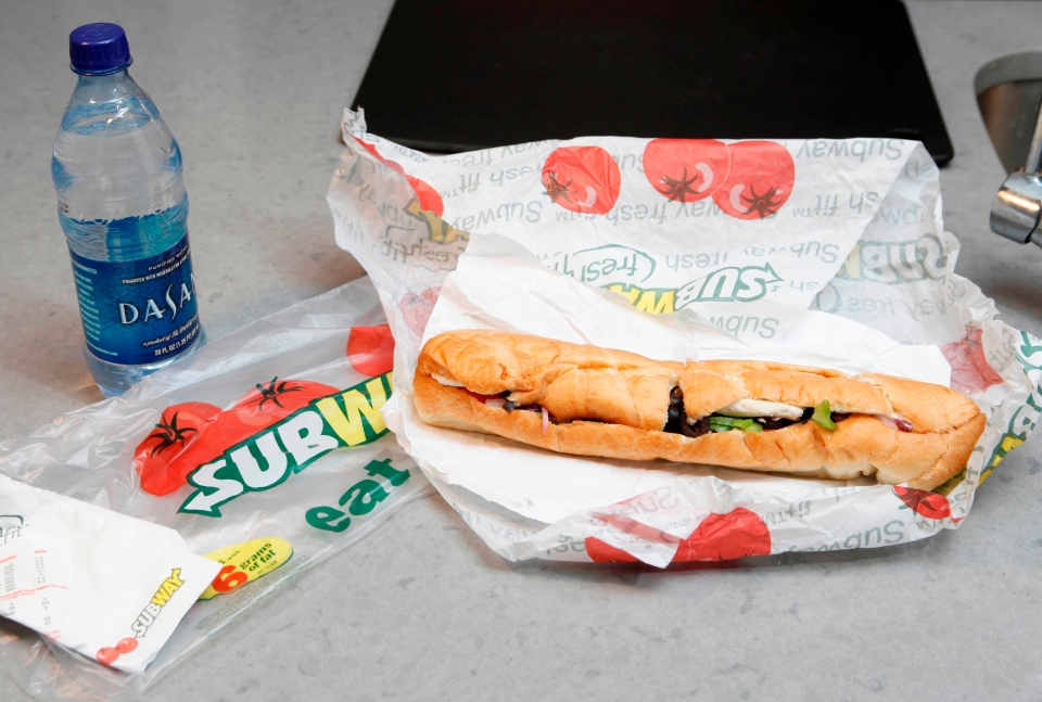 A chicken breast sandwich and water from Subway is shown in this photo taken Aug. 11, 2009.  (AP / Seth Wenig)