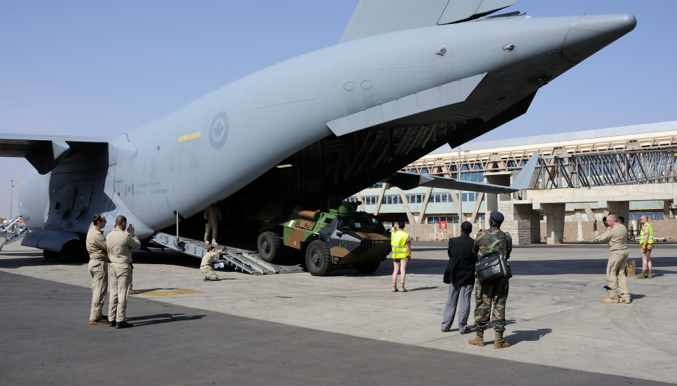 A French military light armored vehicle is unloaded from a Canadian Forces CC-177 Globemaster III in Bamako, Mali, Thursday, Jan. 17, 2013. (Sgt. Matthew McGregor, Combat Camera)