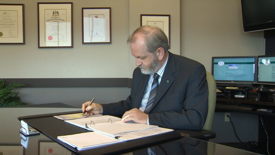B.C. Auditor General John Doyle prepares a report in his office in this file photo. (CTV)