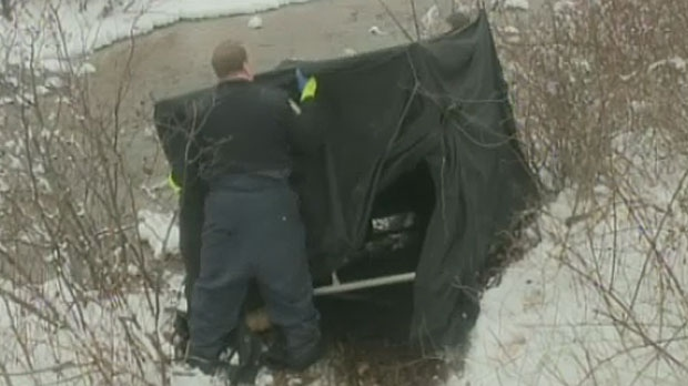 Police spent Thursday using a shovel and ice pick to dig into the frozen riverbank of Renwick Brook in Glace Bay. A small tent-like shelter protected the scene while a propane heater melted the ground below.
