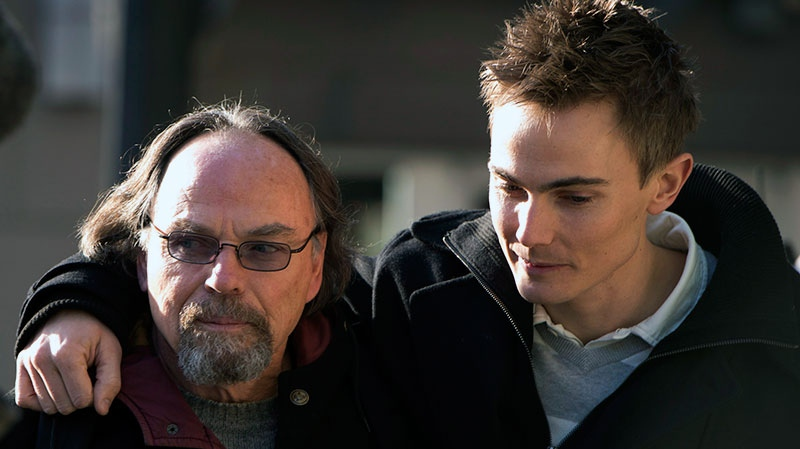 Karl Lilgert is seen leaving at the B.C. Supreme Court with family members in downtown Vancouver, B.C., Thursday, January, 17, 2013. (Jonathan Hayward / THE CANADIAN PRESS)