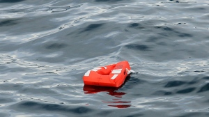 A lifejacket from the Queen of the North ferry floats in the waters of Wright Sound near Hartley Bay, B.C., on March 22, 2006. (Richard Lam / THE CANADIAN PRESS)