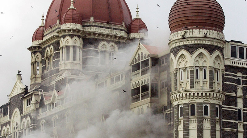 Smoke billows from the Taj Mahal Hotel during a 60-hour rampage through India's financial capital that killed more than 160 people, in Mumbai, India, Nov. 29, 2008. (AP / Altaf Qadri)