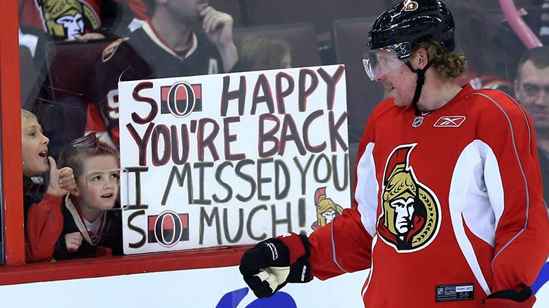 Ottawa Senators team captain Daniel Alfredsson acknowledges two young fans who show their appreciation for his team coming back after the NHL hockey lockout ended at training camp in Ottawa, Sunday, Jan. 13, 2013. (Fred Chartrand / The Canadian Press)