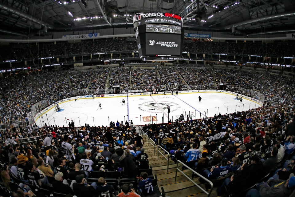 In this photo taken with a fisheye lens, Pittsburgh Penguins fans watch the opening face-off of an NHL intra-squad game in Pittsburgh, Wednesday, Jan. 16, 2013. (AP / Gene J. Puskar)