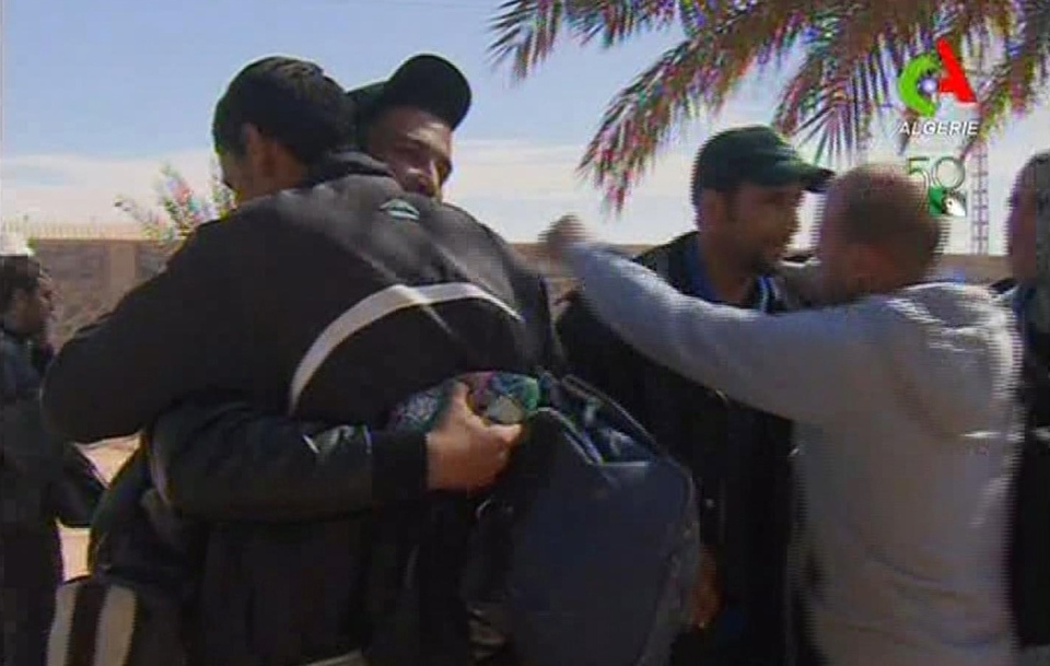 Rescued hostages hug each other in Ain Amenas, Algeria, in this image taken from television Friday Jan. 18, 2013. (Canal Algerie via Associated Press TV)