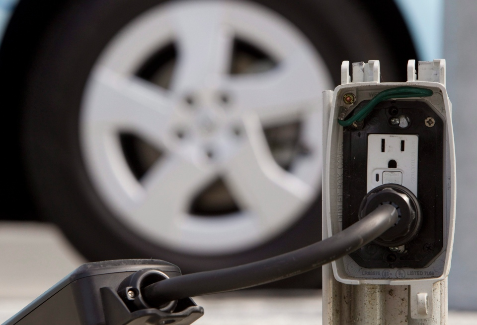 In this Sept. 14, 2010 file photo, a power cable is seen running from an electrical outlet to recharge an electric vehicle in downtown Vancouver, B.C. (THE CANADIAN PRESS/Jonathan Hayward)