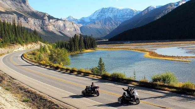 Visitors to Jasper feel the freedom of a chauffeured sidecar tour alongside the Athabasca River in Alberta, in this undated handout photo. (Jasper Motorcycle Tours