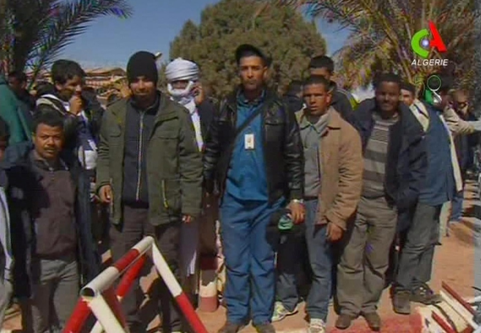 Unidentified rescued hostages pose for the media in Ain Amenas, Algeria, in this image taken from television Friday Jan. 18, 2013. (Canal Algerie via Associated Press TV)