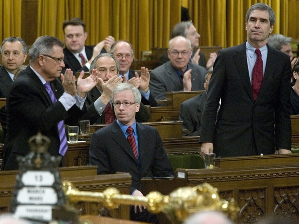 Liberal leader Stephane Dion is appluded by Liberal member Ralph Goodale (left) and other caucus members as Michael Inatieff rises in the House of Commons on Parliament Hill in Ottawa Thursday, March 13, 2008. (Tom Hanson / THE CANADIAN PRESS)