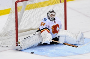 Calgary Flames goalie Miikka Kiprusoff stops a shot by Minnesota Wild's Erik Christensen during a shootout of an NHL hockey game in St. Paul, Minn., in this March 22, 2012 file photo. (AP Photo/ Jim Mone)