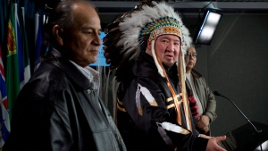 Manitoba Grand Chief Derek Nepinak gestures to Chief Murray Clearskies as they speak with the media Friday January 18, 2013 in Ottawa. (Adrian Wyld / THE CANADIAN PRESS)