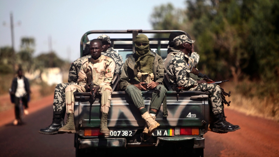 Malian soldiers are seen on their way to Markala, Mali, some 240 kms (150 miles) north of Bamako, Friday, Jan. 18, 2013. (AP Photo / Thibault Camus)