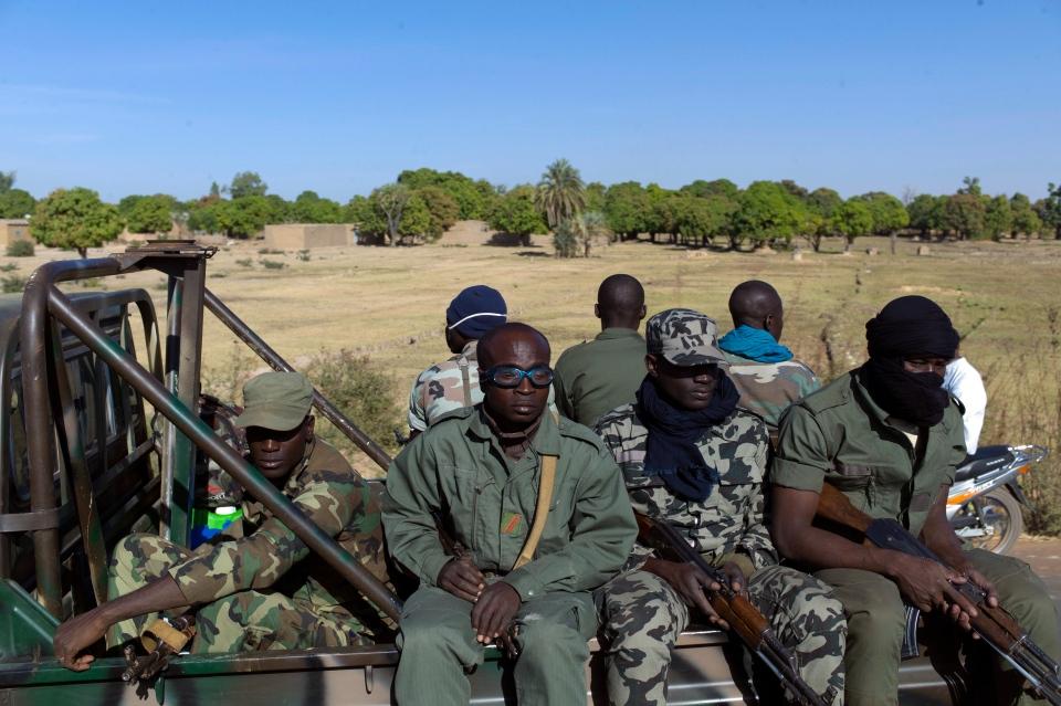 Malian soldiers are seen on their way to Niono, Mali, some 270 kilometres north of Bamako, Friday, Jan. 18, 2013. (AP / Thibault Camus)