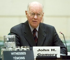 Former justice John Gomery appears before the Commons Estimates committee, in Ottawa on Thursday, March 13, 2008. (Tom Hanson / THE CANADIAN PRESS)