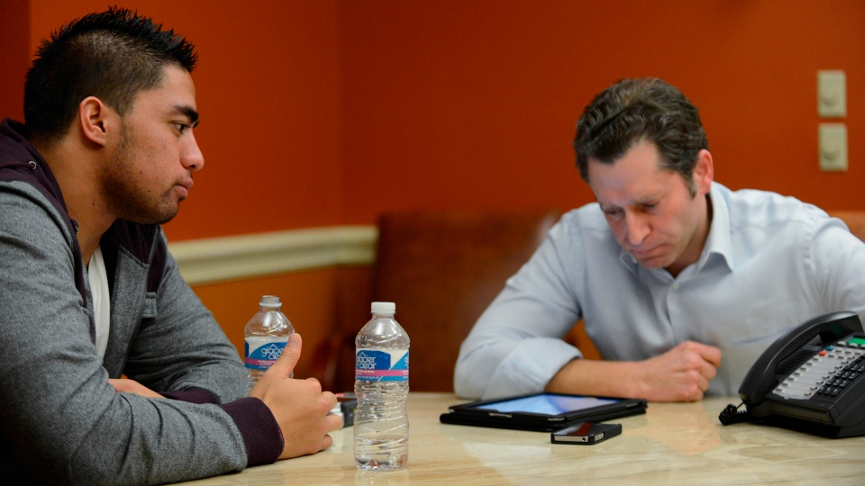 In a photo provided by ESPN, Notre Dame linebacker Manti Te'o listens during an interview with ESPN's Jeremy Schaap, right, in Bradenton, Fla., Friday, Jan. 18, 2013. (AP / ESPN / Ryan Jones)