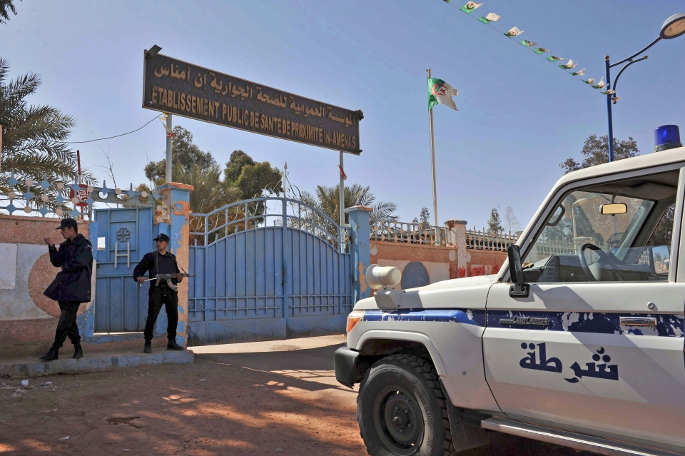 Algerian special police unit officers guard the entrance of an hospital located near the gas plant where hostages have been kidnapped by Islamic militants, in Ain Amenas, Saturday, Jan. 19, 2013 (AP / Anis Belghoul)